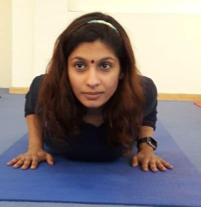 Yoga Practitioner doing Cobra Pose