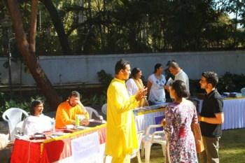 Aditya speaking with visitors of Ananda Pune Spiritual Fair 2017