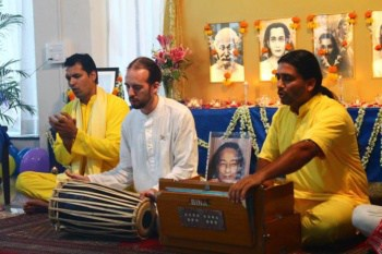 Devotees Playing Kirtan at Ananda Pune Center